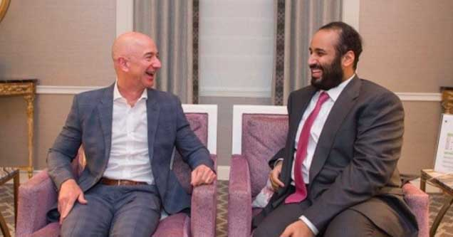 amazons bezos gets his phone hacked by a saudi prince   | Jeff Bezos and Saudi Crown Prince Mohammad bin Salman sitting together