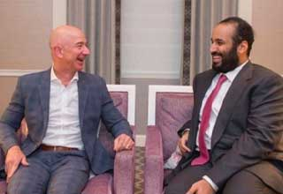 amazons bezos gets his phone hacked by a saudi prince   | Jeff Bezos and Saudi Crown Prince Mohammad bin Salman sitting together