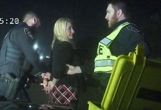rebekah warren congresswoman crash    woman getting arrested by two cops