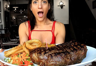 video of a woman eating a huge steak in a short amount of time | a brunette with a huge 96 oz steak