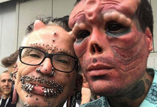 two people with extreme body modifications