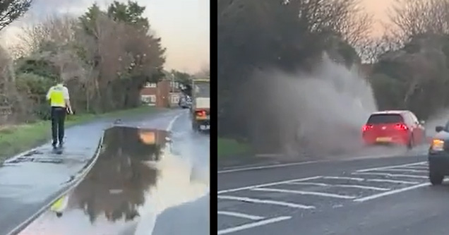 cop walking near a puddle and a red car soaking him | driver gets a cop wet from a puddle