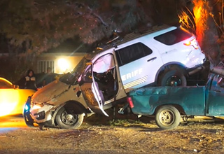 a white sheriff suv that crashed into a truck   pics of  a police car crash