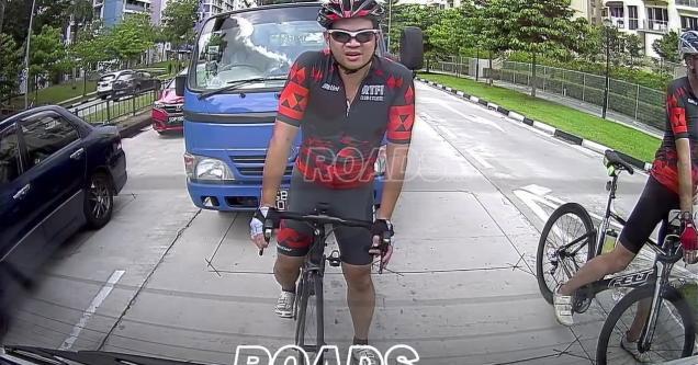 guy riding a bike blocking traffic | video of an entitled cyclist