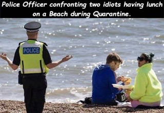 a cop confronting two people on the beach during quarantine