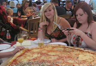 collection of random pictures | a crab pinching a finger, and girls with a huge pizza