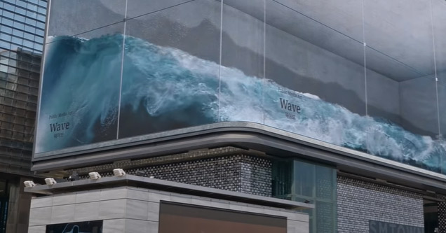 a huge screen with water and waves splashing around | kinetic wall and wave modern art