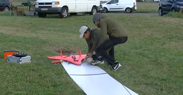 a red rc jet about to take off