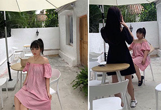 Instagram models get caught faking photos | girl in a pink dress posing near a white table - pic of woman wearing a black dress taking a photo of her friend