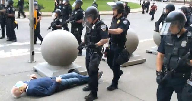 police knocking over an elderly man