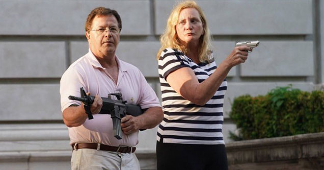 Ken and Karen from St Louis meet protestors outside their homes with loaded guns | ken and karen holding guns