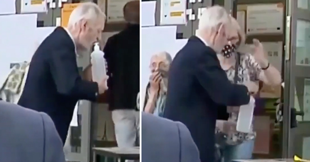 old man in poland drinking hand sanitizer