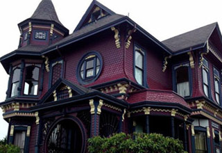 a cool purple blue and black  victorian era house