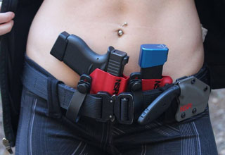 a girl with a gun holster belt