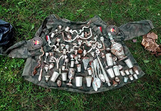 The find contains various silver household items, including goblets and cutlery. One hundred and three silver objects were buried in a rusty decaying box. Each product is said to have been made either in Austria or in Poland.
