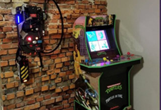 a proton pack and arcade game in a man cave