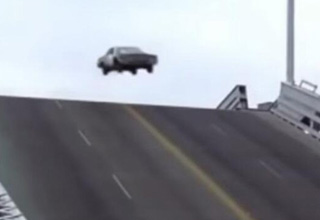 a car jumping a draw bridge