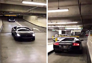 parking attendant watching a lambo drives under toll bar in parking garage