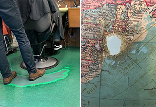 the floor of a hairdresser that's been worn down - a globe at the new york public library worn down where New York is