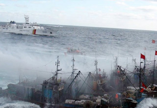 navy and coast guard ships taking down illegal fishing vessels