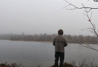 kid fishing with his back to the camera looks like he's
