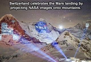 kleine scheidegg - Switzerland celebrates the mars landing by projecting NASA images onto mountain range.