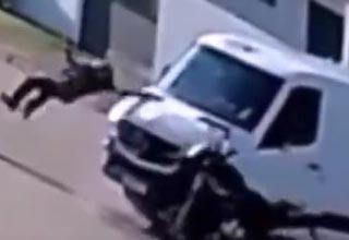 a biker hitting a van and flipping over it