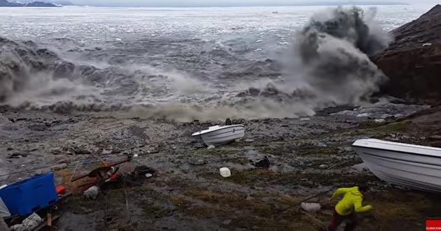 a huge tsunami wave hitting the shore by fisherman