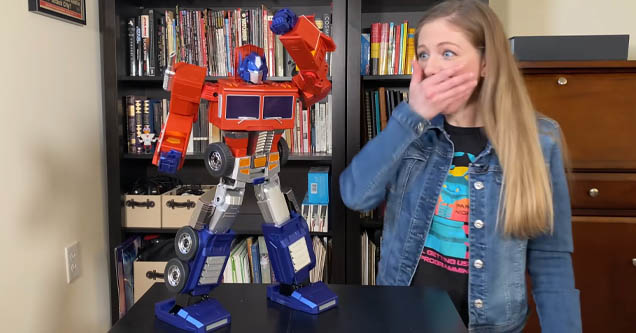 Reporter reacts to self-transforming Optimus Prime robot
