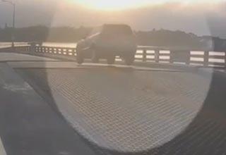 an suv jumping a drawbridge