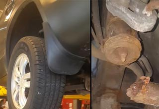 a car on a lift with a strut missing