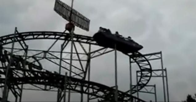 people stuck on a rollercoaster rocking back and forth