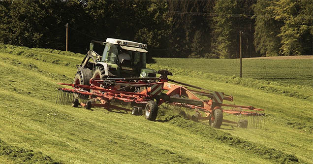 photo - tractor operating on verdant slope