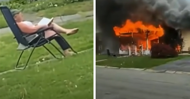 a woman sitting in a lawn chair as her house burns down