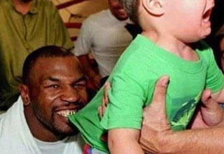 Mike Tyson biting child's shirt