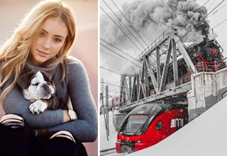 a gorgeous woman holding a small dog and a red train and white snow