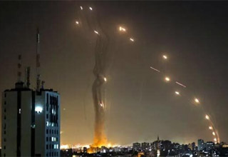 photo - Palestinian rockets being fired at Israeli building