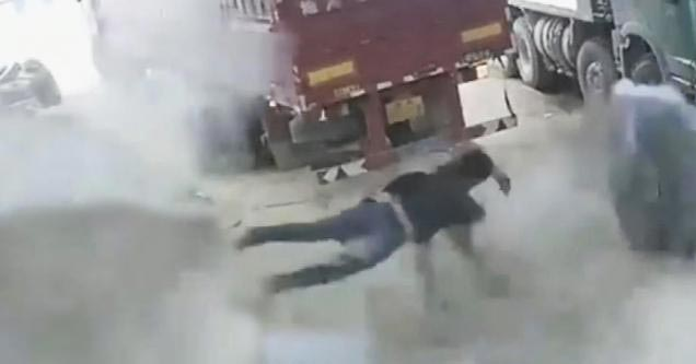 a man flying across the shop after a tire exploded