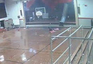a microburst in north carolina blows a wall out of a gym