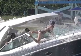 a girl getting bounced off a boat