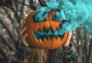 a pumpkin with blue smoke coming out of it