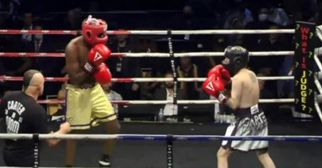 Aaron Carter (silver/black) faces off against Lamar Odom (yellow) in celebrity boxing match