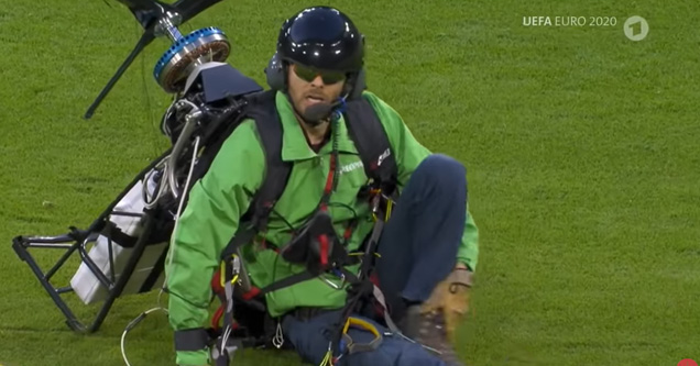 a paraglider who crash landed on the soccer field