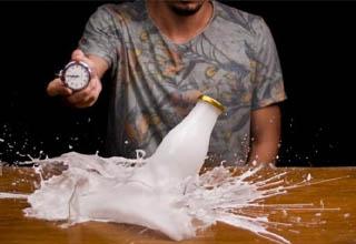 milk bottle breaking in time warp effect video by Macro Room