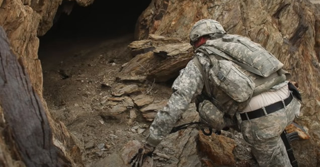 a marine looking into a cave