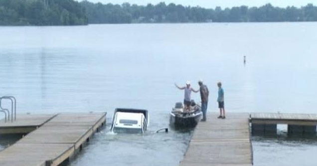 a truck that drove off the boat loading ramp