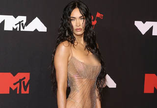 """How a dude like Machine Gun Kelly ever landed <strong><a href=""""https://www.ebaumsworld.com/videos/megan-fox-discussing-crystals-and-astrology-is-cringe-af/86930628/"""" target=""""_blank"""">Megan Fox</a></strong> is beyond me. But we can still appreciate how gorgeous this woman is."""