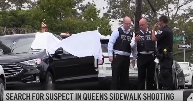 cops standing around a crime scene