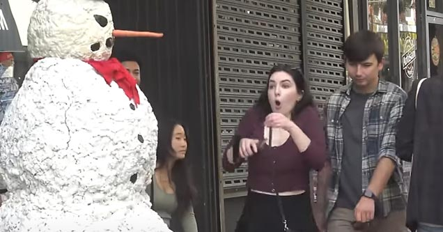 a fake snowman with a person inside scaring people
