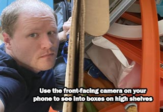 a life hack about using your camera on the phone to see in boxes on shelves